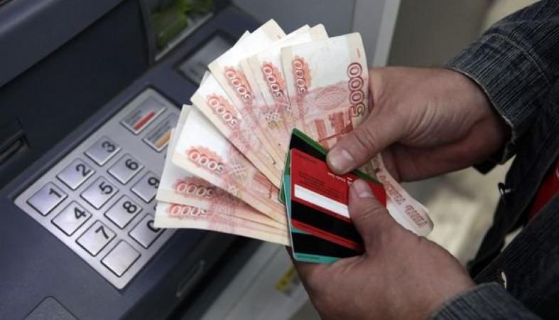 Кража денег из банкомата крючком
